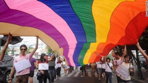 Rainbow flag raised during the Metro Manila Pride March